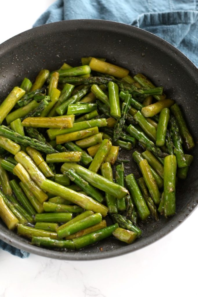 sauteed asparagus, the only way my family will eat asparagus is this quick and easy sauteed asparagus recipe. Full of flavor and 5 ingredients