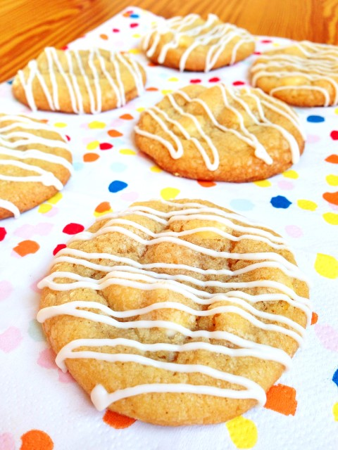 Delicious. chewy cookies, studded with white chocolate chips, lightly flavored with lemon and drizzled with more chocolate