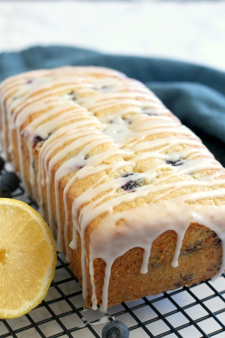 Easy Sour Cream Lemon Blueberry Bread Recipe. This recipe is the best lemon blueberry bread ever. So soft and moist. A perfect summer blueberry dessert recipe.