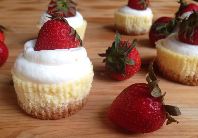 The lightest, fluffiest lemon cheesecake you will ever have. Topped with whip cream and a strawberry. - Chocolate with Grace