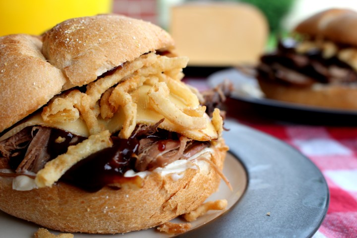 """Smoked Barbecue Beef Brisket Sandwiches. These """"smoked"""" barbecue beef brisket sandwiches are actually made in the slow cooker. Fork-tender, they are delicious topped with barbecue sauce, mayo, smoked Gouda cheese and crispy onion straws. My husband declared them one of the best sandwiches ever."""