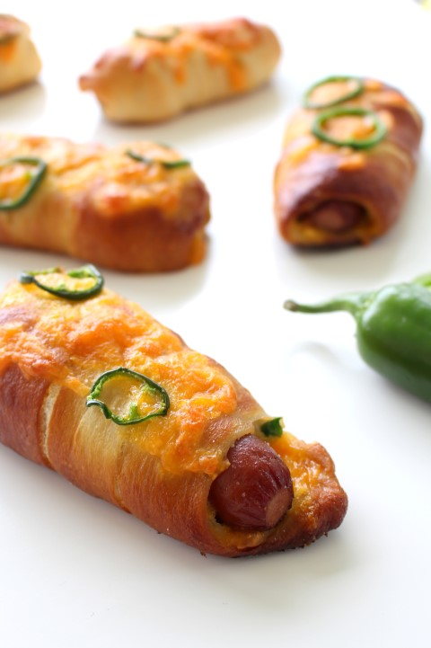 Jalapeno Popper Pretzel Dogs. A hot dog wrapped in soft, chewy pretzel dough stuffed with cheese and jalapenos.