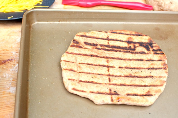 Whole Wheat Grilled Pizza Crust. Pizza on the grill is surprisingly easy and delicious. This whole wheat pizza crust is not only healthy, but quick to make and can be ready in less than 45 minutes.