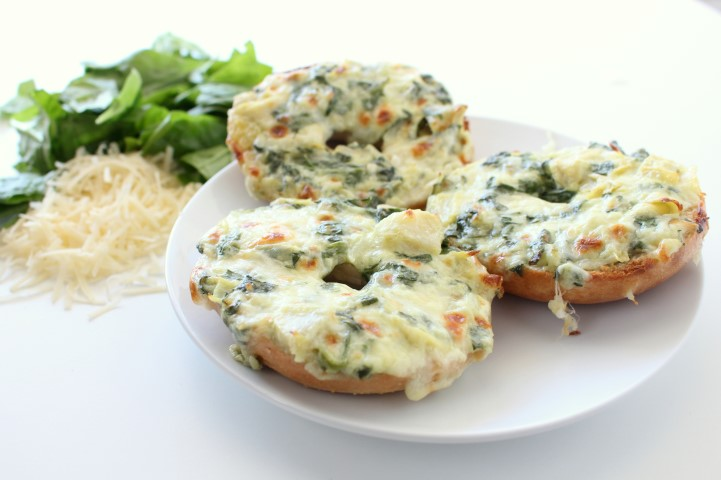 Spinach and Artichoke Dip baked on top of mini bagels. The classic dip gets a makeover in these cute little appetizers.