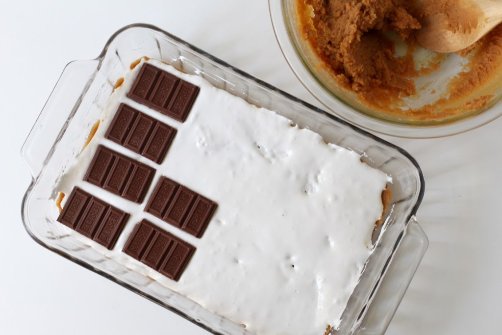 5 ingredient peanut butter s'mores bars have a layer of marshmallow and milk chocolate sandwiched between two layers of peanut butter blondie