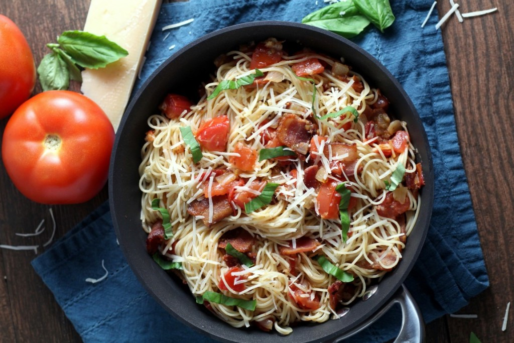 Pasta for Two. Perfect Date night in recipe! features thin capellini tossed with crispy bacon and juicy tomatoes, seasoned with garlic, onions and basil