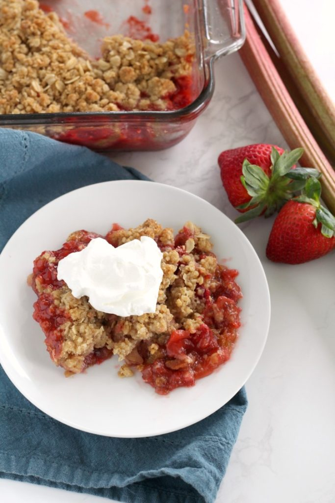 Strawberry Rhubarb Crisp is a quick and easy springtime dessert that is perfect for last minute guests. Fresh rhubarb and sweet strawberries topped with a crunchy oatmeal crumble make a dessert no one will forget. Top with whipped cream or vanilla ice cream.