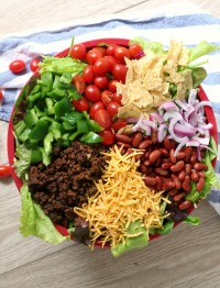 Big Picnic Taco Salad is a fun, healthy potluck or party dish. Try this potluck side dish recipe for your next party. It full of beef, serves a crowd and is everybody's favorite.