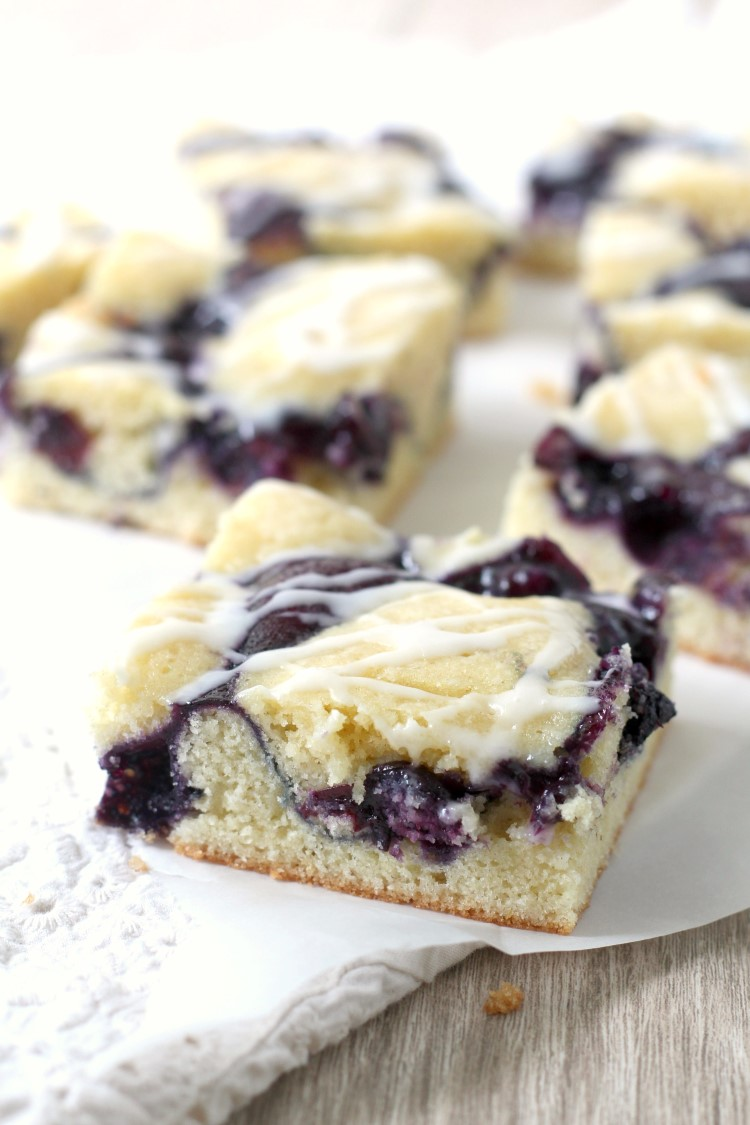 These easy blueberry pie bars are a perfect summer dessert for any picnic, potluck or party. You can either use my easy homemade blueberry pie filling, or take as shortcut and use canned pie filling.