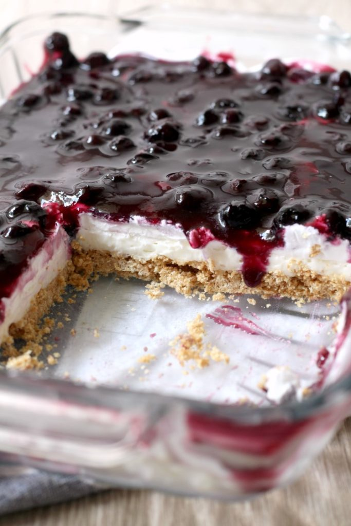 No Bake Blueberry Cheesecake Bars with a graham cracker crust. An easy summer dessert recipe