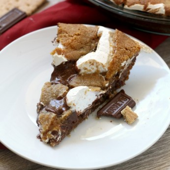 Nutella Smores Cookie Pie. An fun indulgent s'mores dessert. Everyone will love the warm graham cracker cookie, sticky marshmallow and rich hazelnut chocolate layer. Be sure to have friends around to help you eat it.
