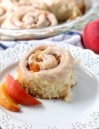 Brown Sugar Peach Sweet Rolls are a fun summer breakfast or brunch treat. A perfect summer fruit dessert recipe that can be frosted with either cream cheese or brown butter frosting.