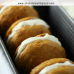 Pumpkin whoopie pies with cream cheese filling are a fun Amish classic recipe that makes an easy fall dessert recipe. Gather the family and kids around for this easy pumpkin baking recipe. #pumpkin #thanksgiving #dessert #pumpkincake