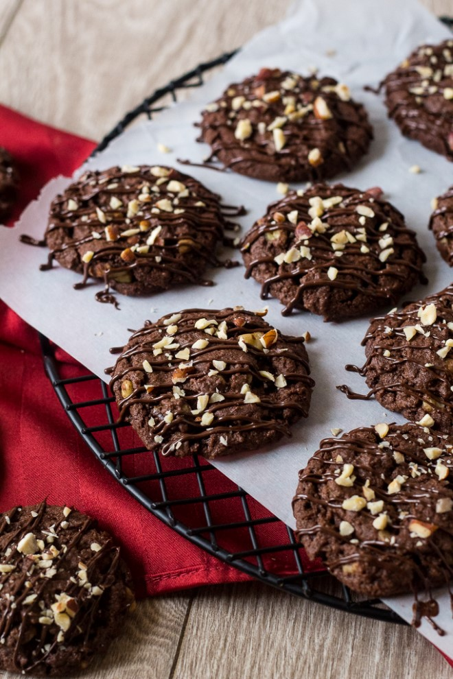Chocolate Hazelnut cookies cooling on a wire rack with a red napkin