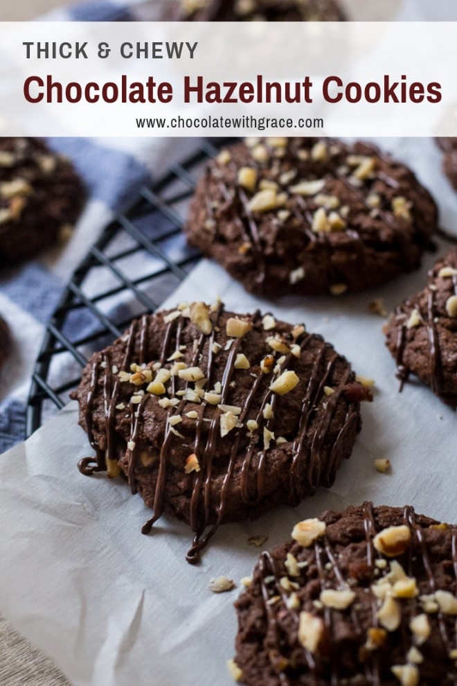 Chewy Chocolate Hazelnut cookies on parchment paper on a wire rack with chocolate drizzle