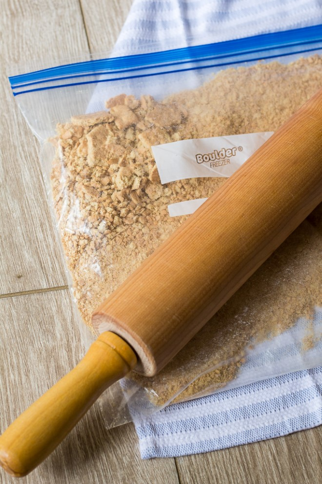 crushing graham crackers with a rolling pin