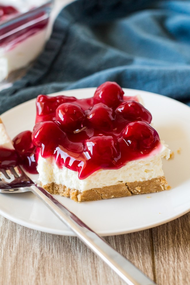 piece of no bake cherry cheesecake on a plate