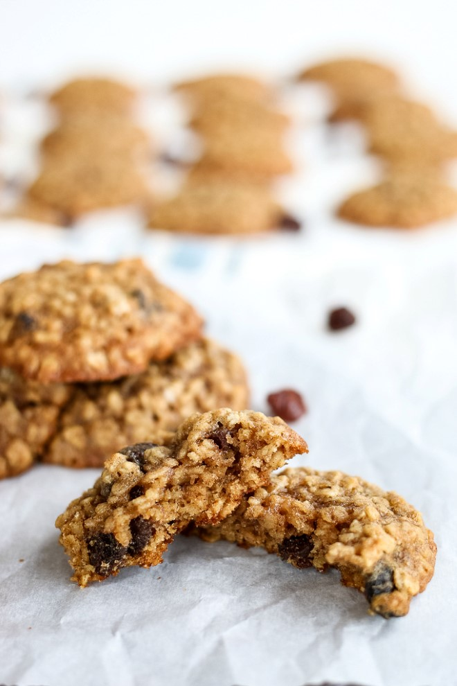 Oatmeal cookies with raisins baked on parchment paper.