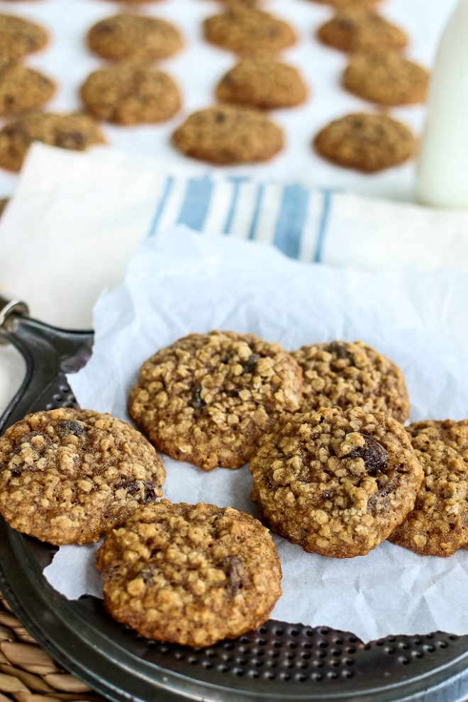 Oatmeal cookies recipe with raisins on parchment paper.