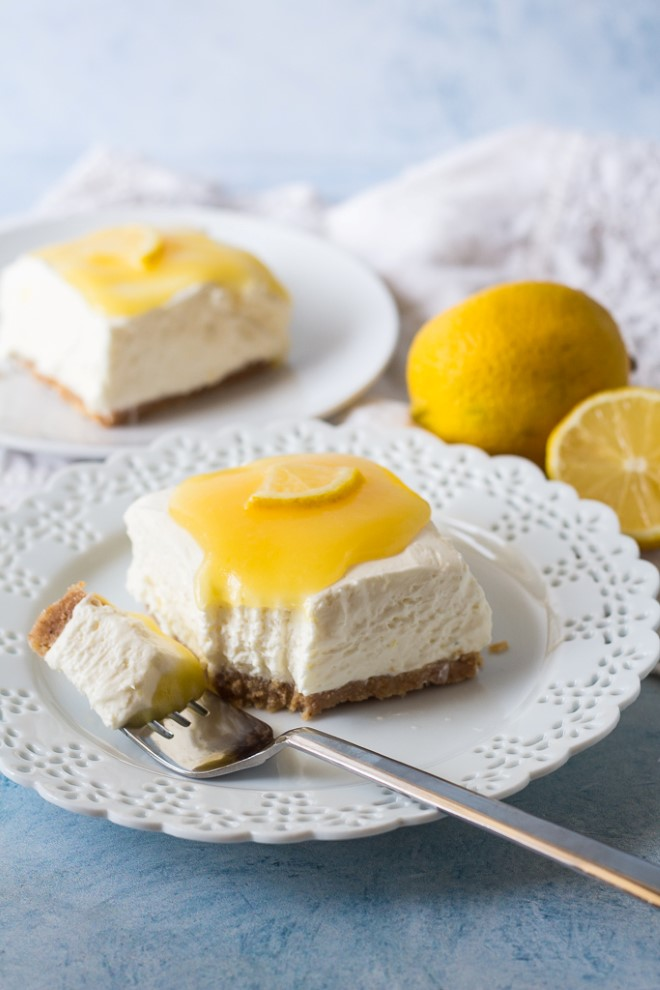 no bake lemon cheesecake with a fork bite taken out
