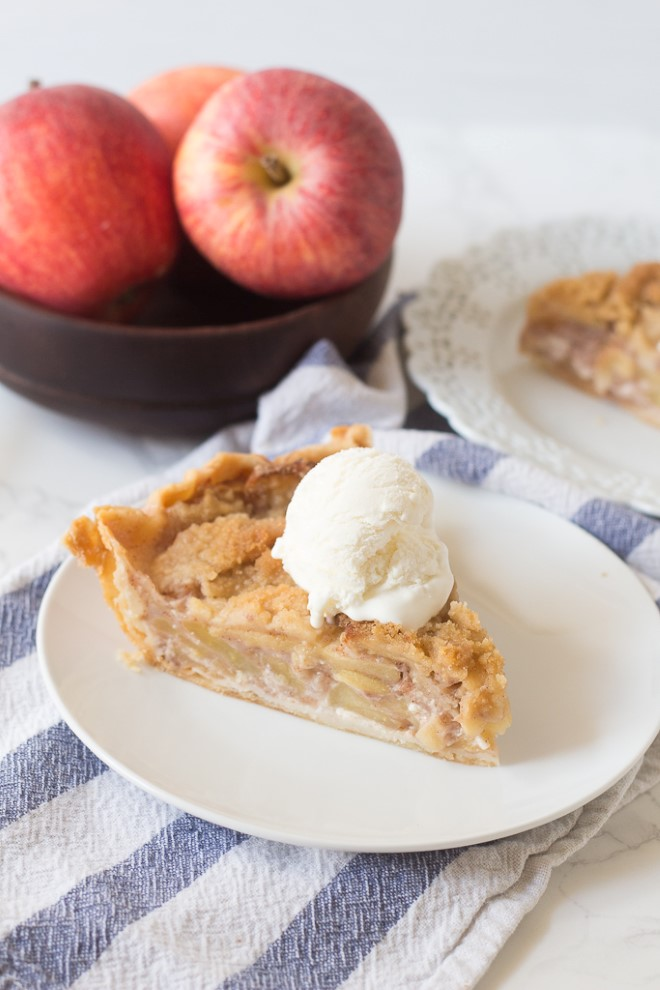 a piece of the best apple pie with crumb topping on a plate
