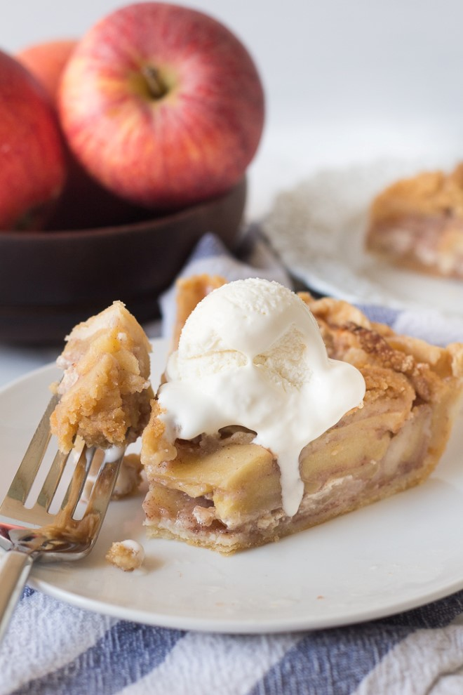 apple crumb pie with a bite taken out.