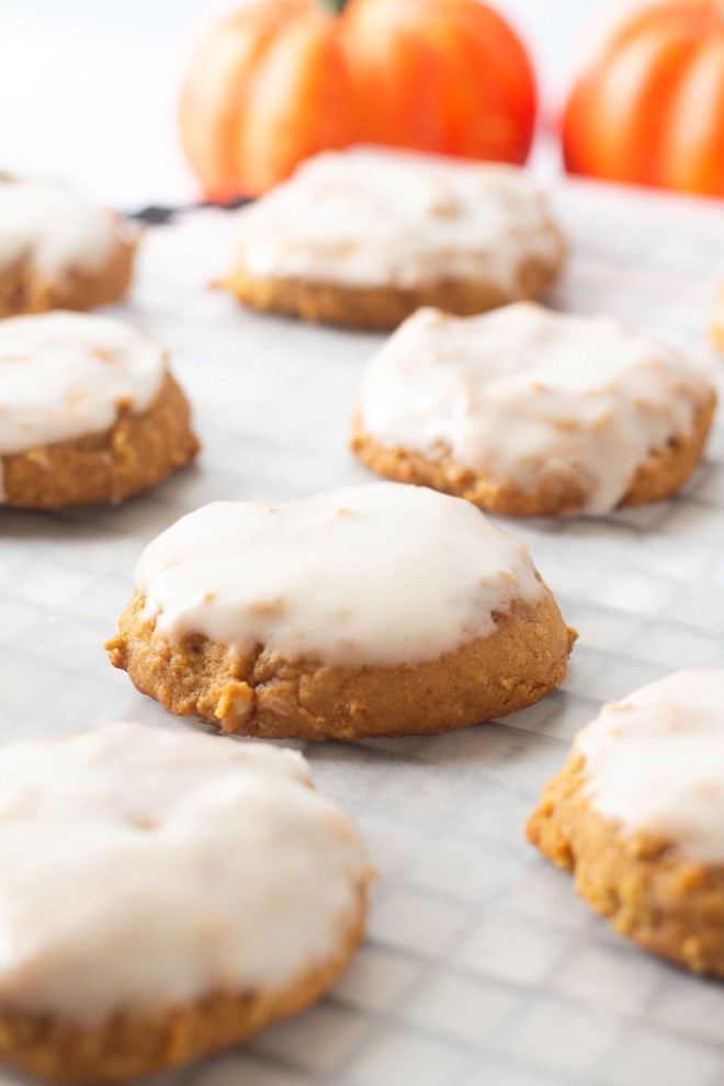iced pumpkin oatmeal cookies on a baking rack