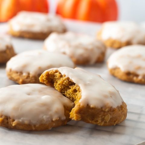 iced pumpkin oatmeal cookie with a bite out