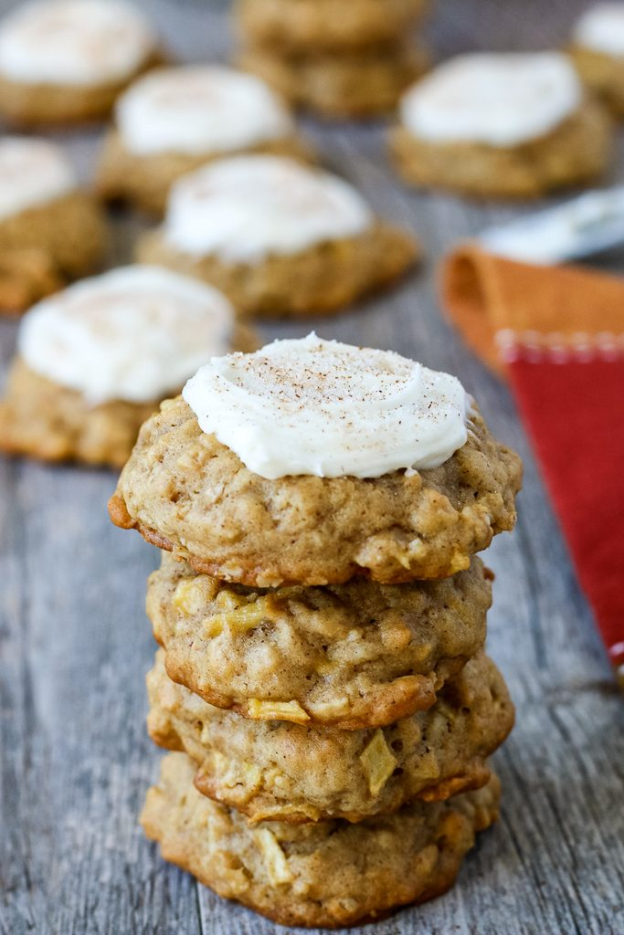 Finished oatmeal apple cookies with fresh apples and icing added on top.