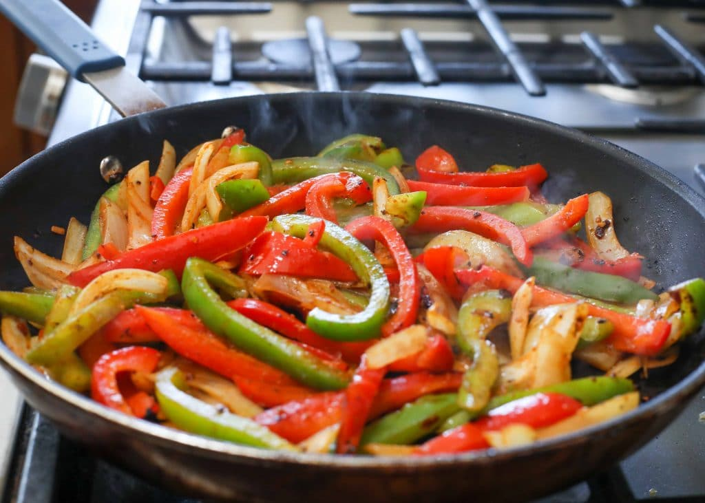 Bell peppers sauteeing for fajitas