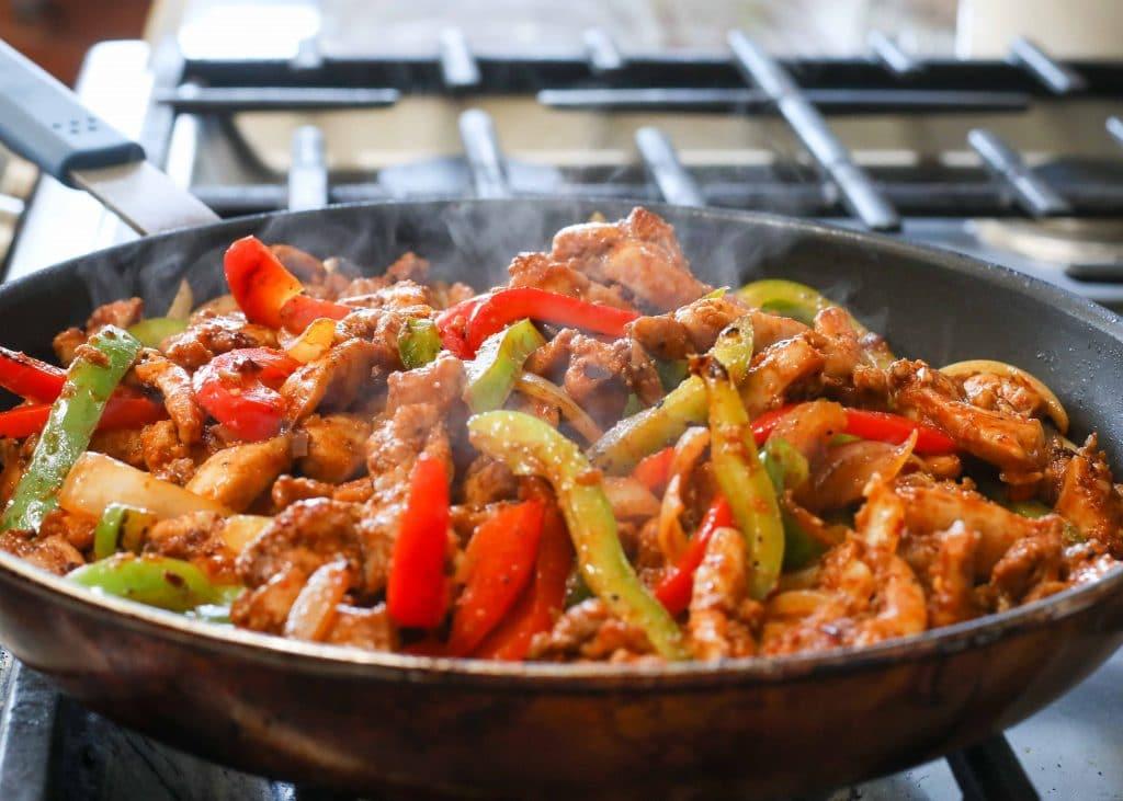 Steaming chicken fajita skillet